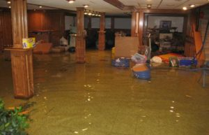 Flooded basement in need of water restoration services.